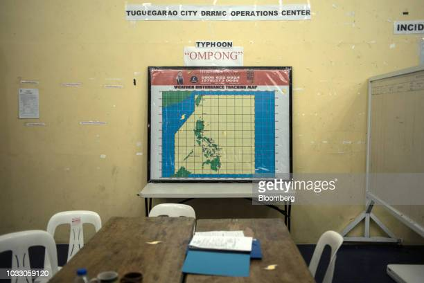 A weather disturbance tracking map is displayed at a makeshift disaster relief operations center ahead of Typhoon Mangkhut's arrival in Tuguegarao...