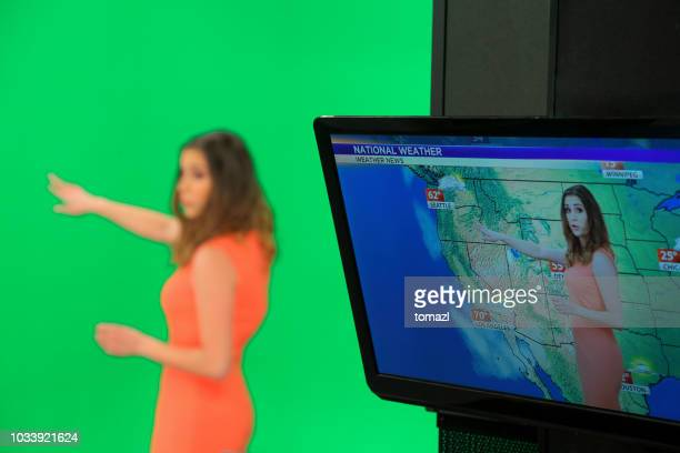 weather forecaster on green background - meteorology stock pictures, royalty-free photos & images