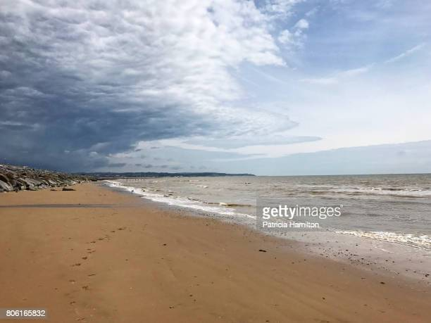 weather front at dymchurch beach - english channel stock photos and pictures