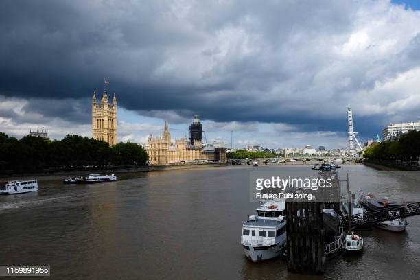 A weather front passes over the river Thames and Westminster Lambeth Bridge London UK 5th August 2019
