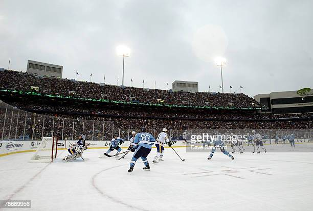 Weather looms as the Buffalo Sabres get the puck out of their zone in the second period of the NHL Winter Classic against the Pittsburgh Penguins at...
