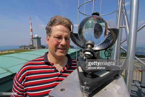 Weather observer Michael Huebler checks a sunshine recorder on the rooftop of the weather station located on Brocken mountainGermany 04 July 2015 A...