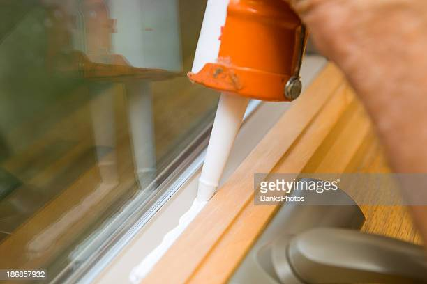 Weather Seal Caulk being applied to Window Frame