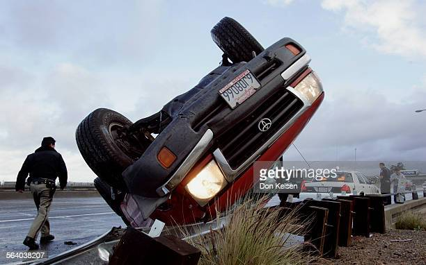 – – Weather slicked southland highway were hazardous to drivers Wednesday morning In Irvine CHP Officer Rick Lozano inspects pickup truck that...