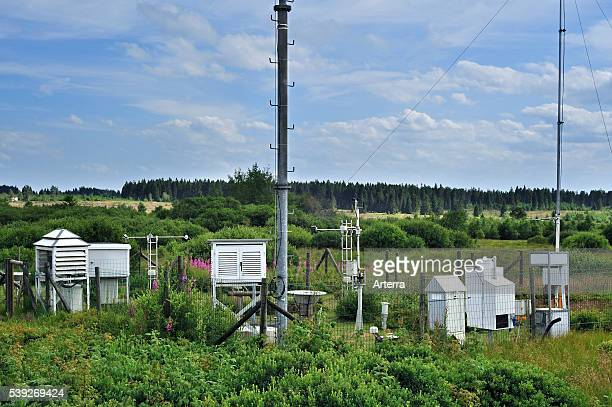 Weather station measuring temperature wind speed and precipitation at Mont Rigi in the snow in winter in the High Fens / Hautes Fagnes Belgian...