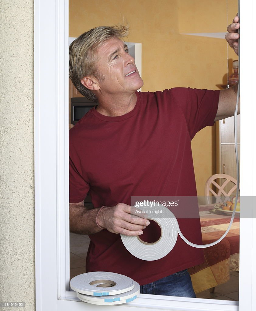 Weather Stripping Man MS : Stock Photo