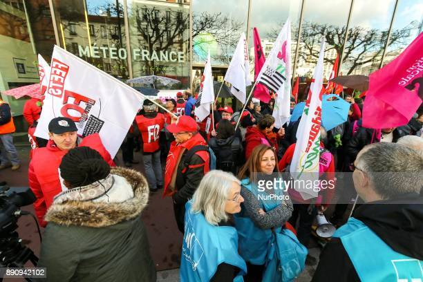 Weather technicians of French national meteorological service Meteo France gather in front of the compagnys headquarters against the abolishment of...