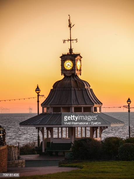 Weather Vane On Clock Tower By Sea Against Sky During Sunset At Broadstairs