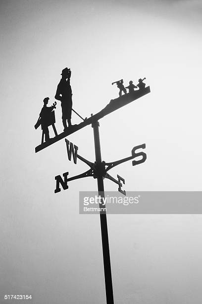 Weather vane with a golfer and caddy. Undated.