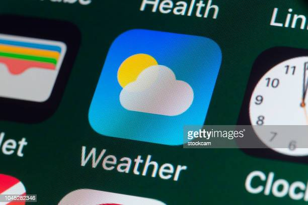 weather, wallet, clock and other apps on iphone screen - meteorology stock pictures, royalty-free photos & images