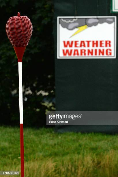 Weather warning sign is seen near the first green during Round One of the 113th U.S. Open at Merion Golf Club on June 13, 2013 in Ardmore,...