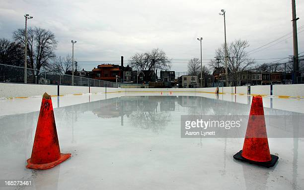 Water lies on top of the ice due to extensive melting at Harry R Gairey Ice Rink in Alexandra Park at the corner of Dundas and Bathurst Sreets Monday...