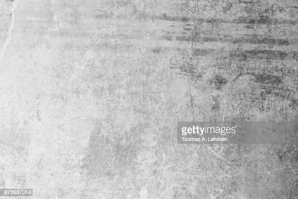 weathered, aged and scratched concrete wall texture background. - concrete stock pictures, royalty-free photos & images