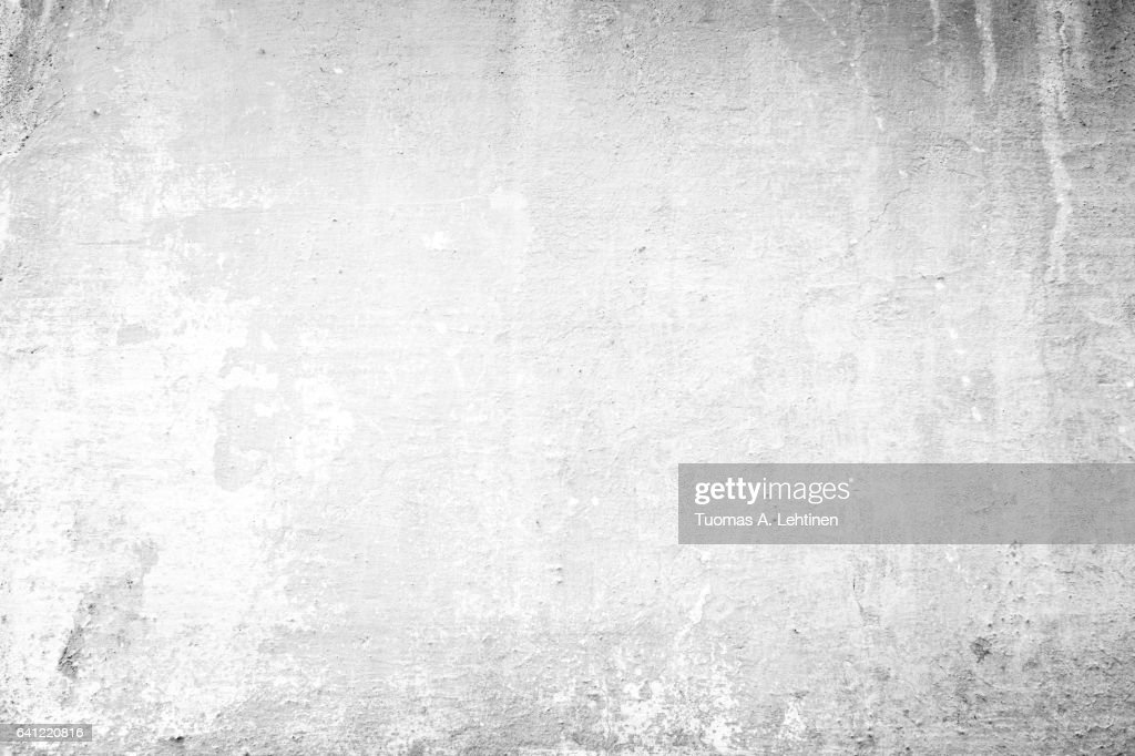 Weathered and aged concrete wall, paint peeled off in black&white. : Stock Photo