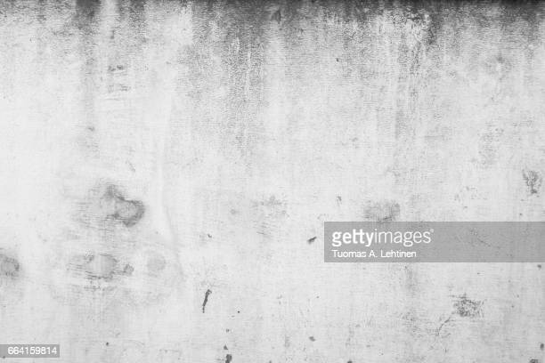 Weathered and aged concrete wall texture background in black&white.