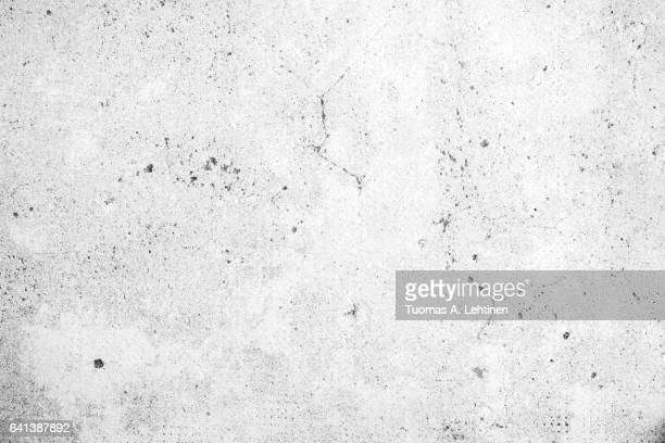 Weathered and aged grey concrete wall texture background in black&white.