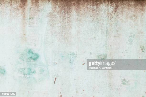 Weathered and aged turquoise concrete wall texture background.