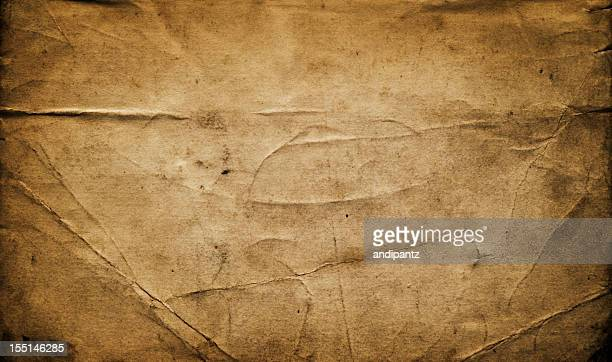 Weathered and creased antique paper background