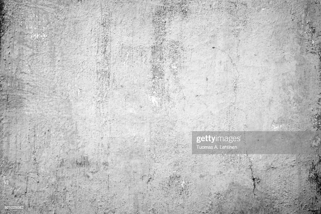 Weathered and dirty concrete wall texture background in black and white with vignetting : Stock Photo