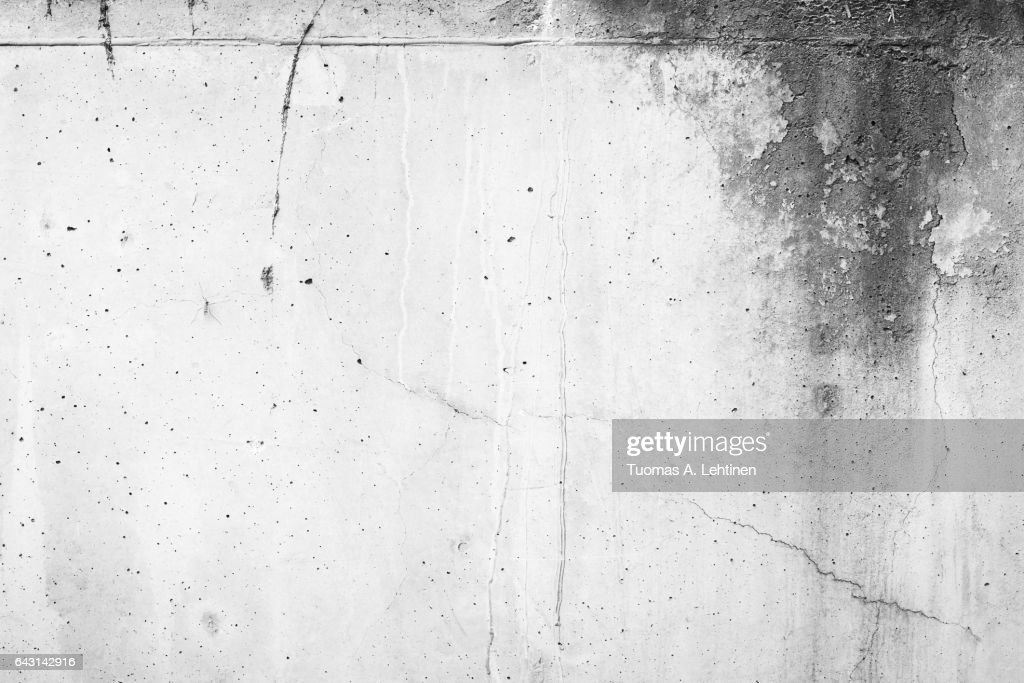 Weathered and moldy concrete wall with cracks in black&white. : Stock Photo