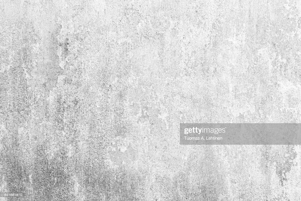 Weathered and old concrete wall with paint peeled off in black&white. : Stock Photo
