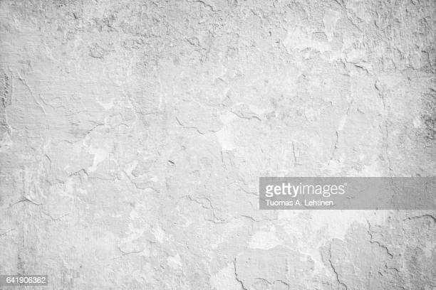 Weathered and peeled off concrete wall texture in black&white.