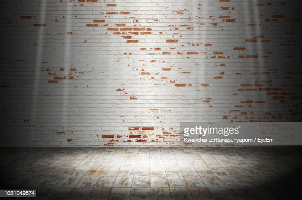 weathered brick wall at home - vignette stock photos and pictures