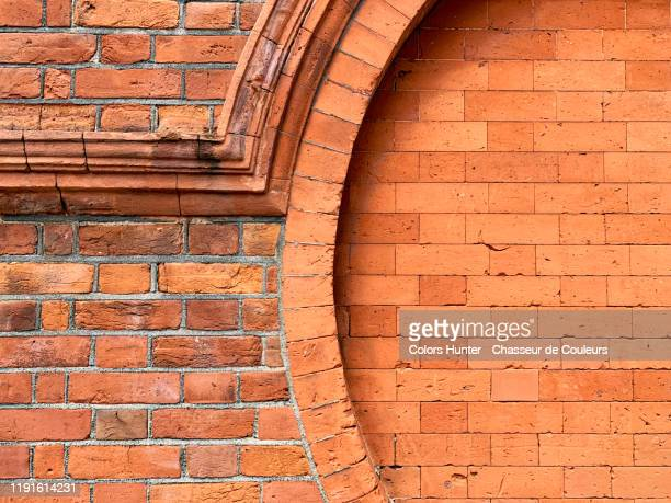 weathered brick wall with rounded shapes from london - building exterior stock pictures, royalty-free photos & images