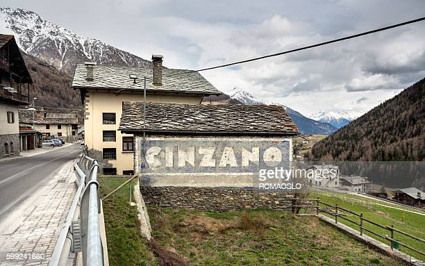 Weathered Cinzano sign on a wall, Aosta Valley Italy