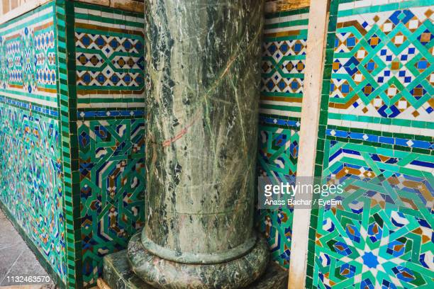 Weathered Column Against Designed Wall At Mosque