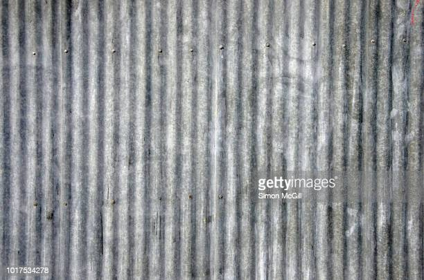 Weathered corrugated galvanised iron fence