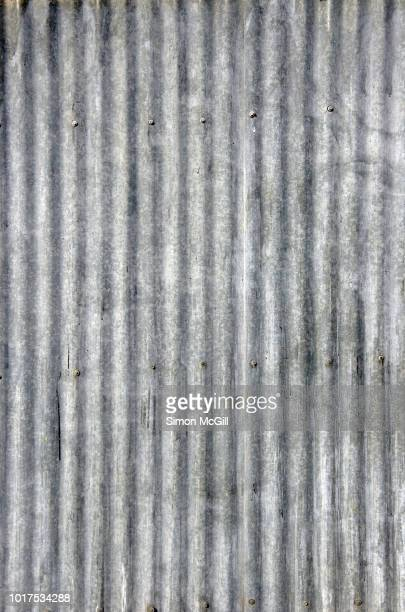 weathered corrugated galvanised iron fence - corrugated iron stock photos and pictures