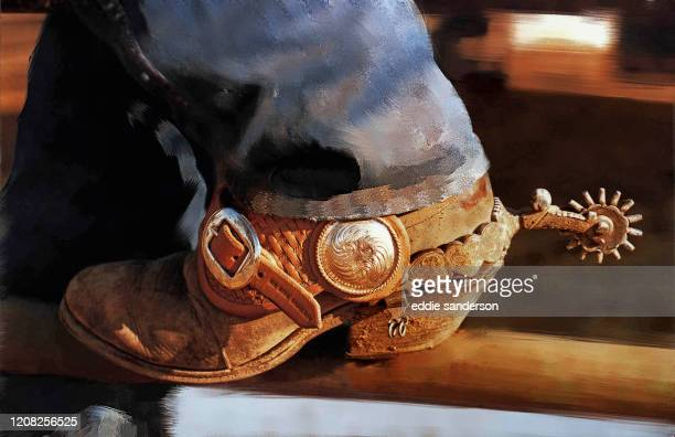 Weathered cowboy boot photographed and digitally enhanced at annual cowboy rodeo in Houston, Texas..