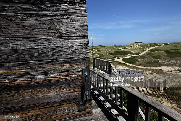 A weathered door on the shack used by Janet Armstrong The outer dunes at the Cape Cod National Seashore by Provincetown and Truro and the dune shacks...
