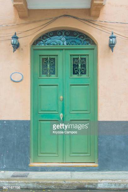 weathered door to old colonial house in casco antiguo, panama - colonialism stock photos and pictures