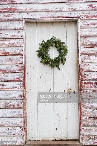 Weathered doorway with Christmas wreath
