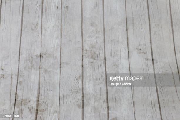 Weathered hardwood floor paneling