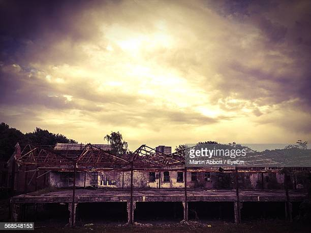 weathered house on field against cloudy sky during sunset - macclesfield stock photos and pictures