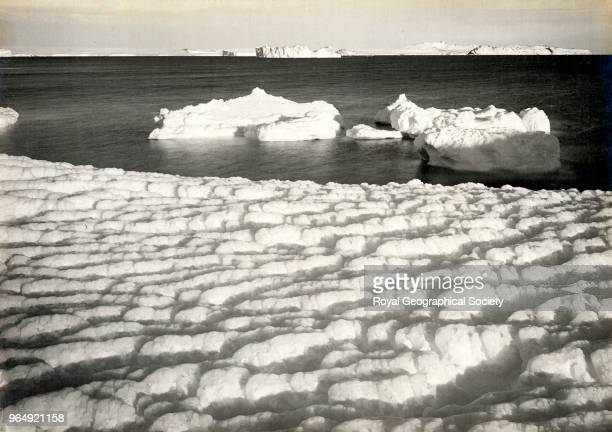 Weathered ice after blizzard at Cape Evans looking to Castle Rock Antarctica 8th March 1911 British Antarctic Expedition 19101913