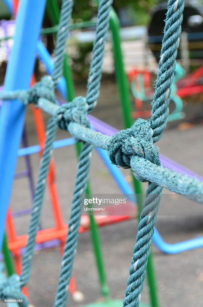 Weathered Knot Rope Climbing Net At Children Playground As A Symbol