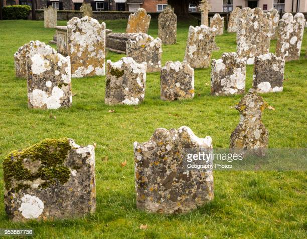 Weathered limestone gravestones Amesbury Abbey church Amesbury Wiltshire England UK