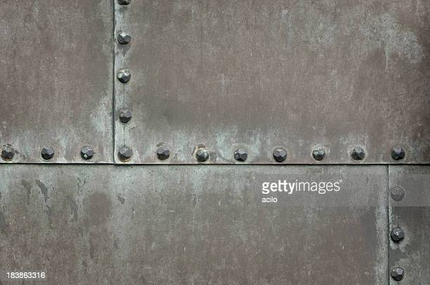 Weathered metal surface with rivets