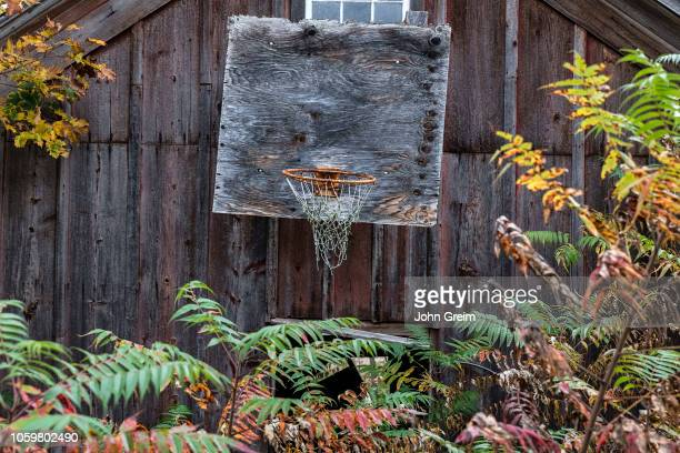 Weathered old basketball hoop attached to a barn