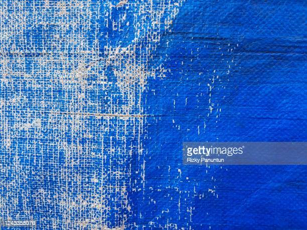 weathered old tarpaulin texture - tarpaulin stock pictures, royalty-free photos & images