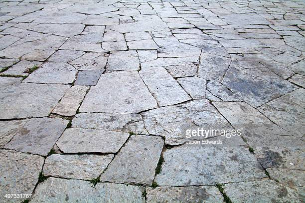 Weathered paving stones in the courtyard of a Buddhist monastery.