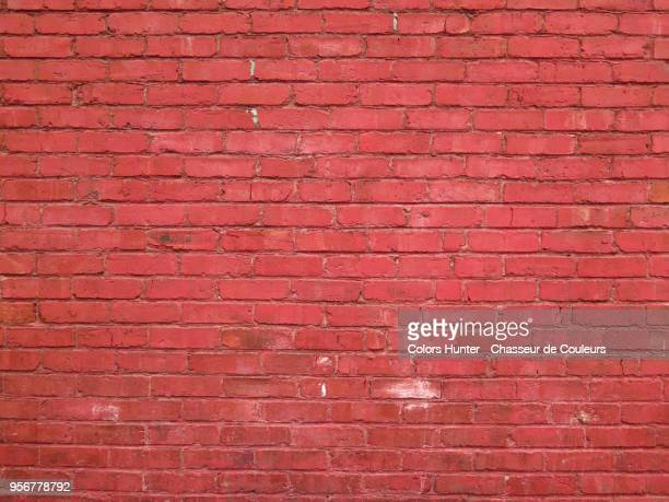 weathered red bricks wall - brick wall stock pictures, royalty-free photos & images
