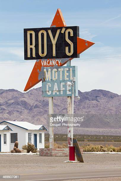 weathered roys cafe and motel neon sign on route 66 - amboy california stock photos and pictures
