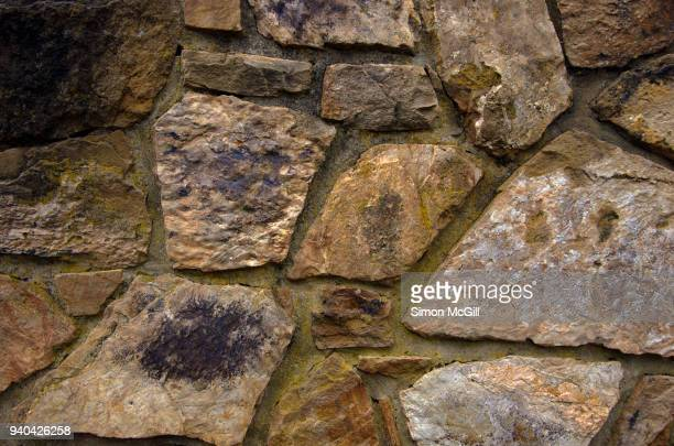 weathered stone wall - retaining wall stock pictures, royalty-free photos & images