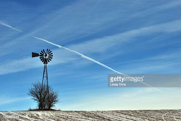 weathered windmill against sky - old windmill stock photos and pictures