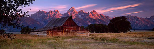 Weathered Wooden Barn with mountains behind